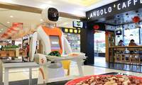 Robot serves customers in a high-tech highway restaurant in Chongqing